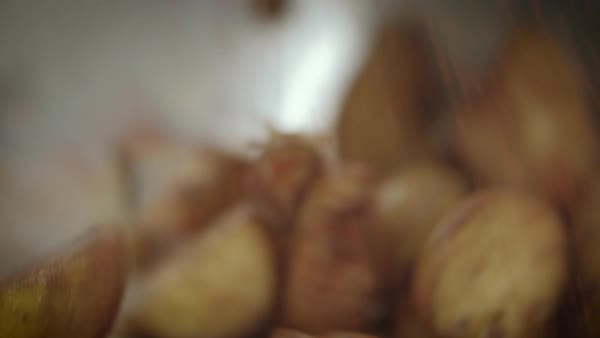 Close-up shot of roast potatoes being tossed Royalty-free stock video