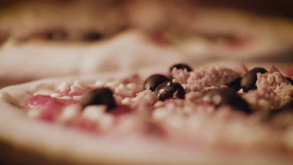 Hand-held shot of pizzas being baked in a brick oven Royalty-free stock video