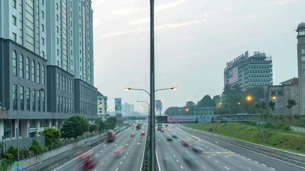Footage of traffic timelapse at Kuala Lumpur during sunrise. Zoom out. Royalty-free stock video