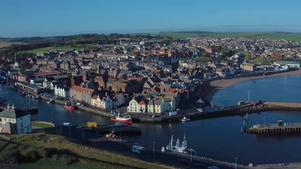 Aerial footage flying to the right overlooking over the coastal town of  Eyemouth, Berwickshire in the Scottish Borders stock footage