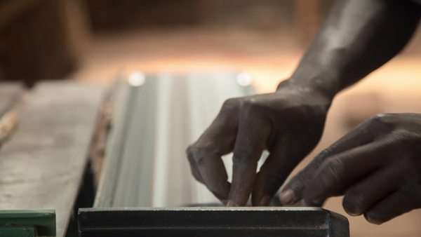 Close-up shot of luthier sanding a piece of wood Royalty-free stock video