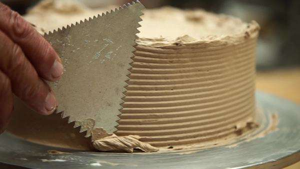 Slow motion of a baker shaping a cake Royalty-free stock video