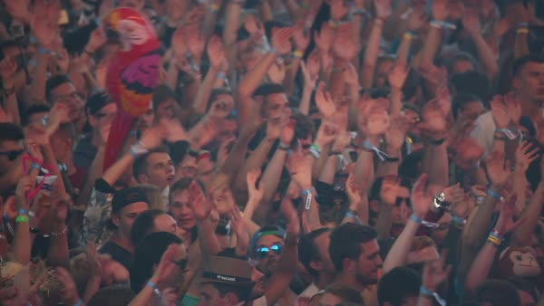 Panning shot of crowd waving arms at a concert Royalty-free stock video