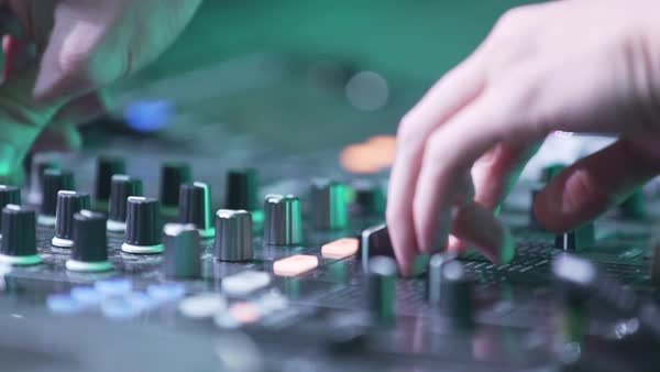 Hand-held shot of a disc jockey playing music Royalty-free stock video