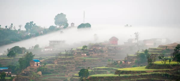Timelapse of fog rolling over a village in Nepal Royalty-free stock video