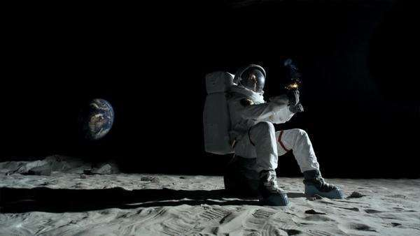 Slow Motion Wide Shot Pan Astronaut Sitting On A Rock On