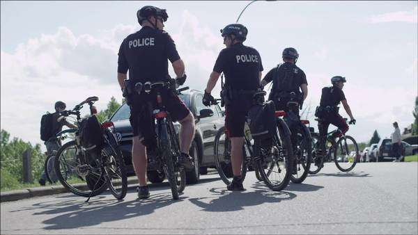 Police on bicycles securing affected areas Royalty-free stock video