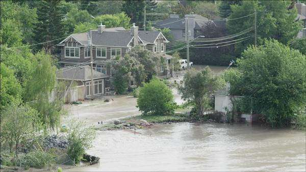 Flooded community from top of hill showing houses surrounded by water Royalty-free stock video