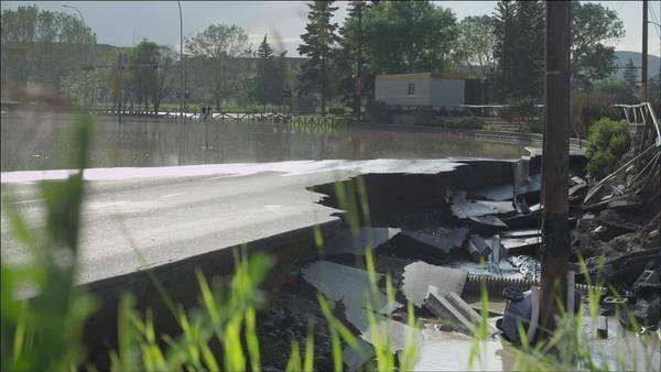 Destroyed road from flood at the Calgary Stampede grounds Royalty-free stock video