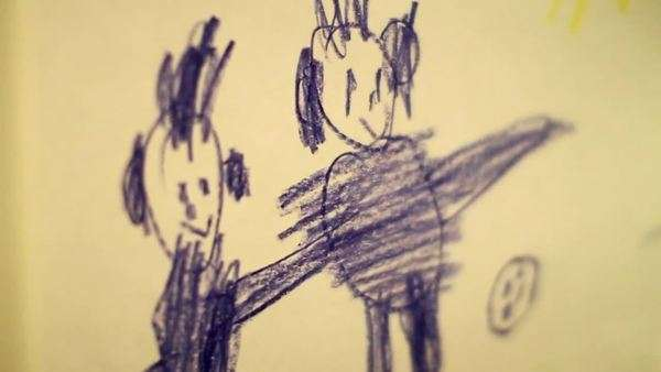 Child's drawing depicting two human figures holding hands Royalty-free stock video