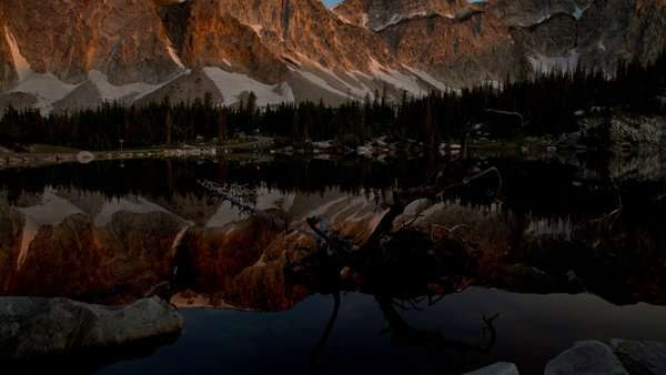 Tracking sunrise timelapse of changing light against a fallen tree at Mirror Lake, Wyoming Royalty-free stock video