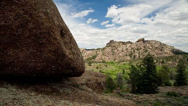 Motion control timelapse tracking across a rock in front of clouds and Vedauwoo rock formations Vedauwoo, Wyoming Royalty-free stock video