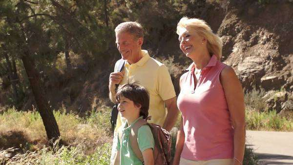 Grandparents and grandson walking in countryside. Royalty-free stock video