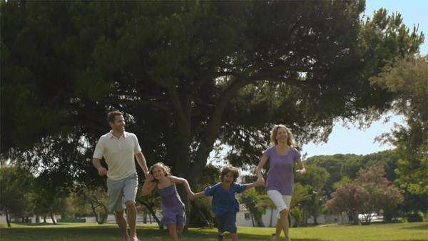 Slow motion shot of family running in park. Royalty-free stock video