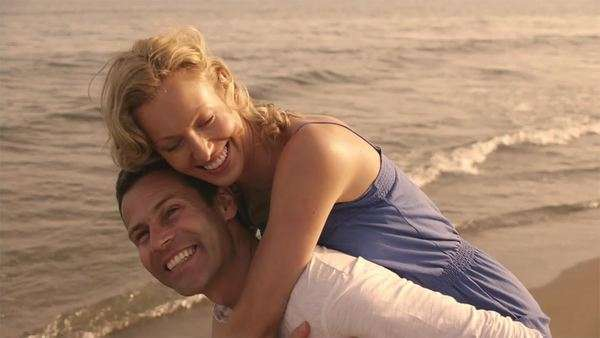 Shot of playing couple on beach. Royalty-free stock video