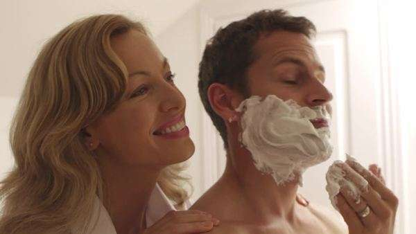 Couple embracing while man is shaving. Royalty-free stock video