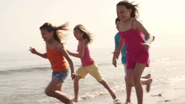 Slow motion of five children running on beach. Royalty-free stock video