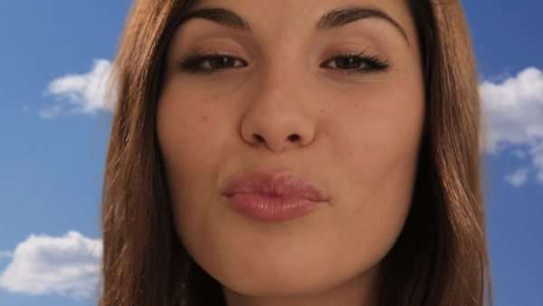 young woman blowing kiss Royalty-free stock video