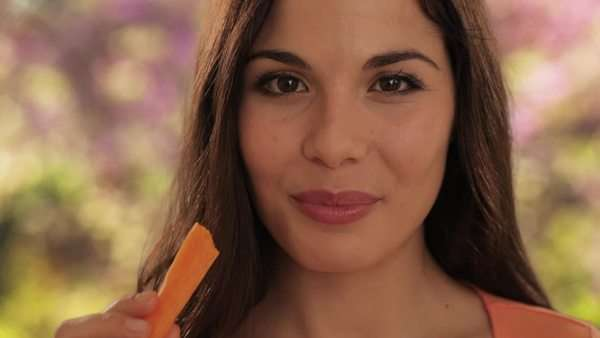 young woman eating carrot Royalty-free stock video