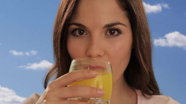 young woman drinking orange juice Royalty-free stock video