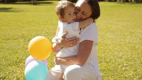 mother and baby in park playing with balloons Royalty-free stock video