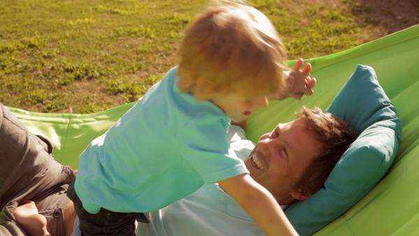 father and son on garden hammock Royalty-free stock video