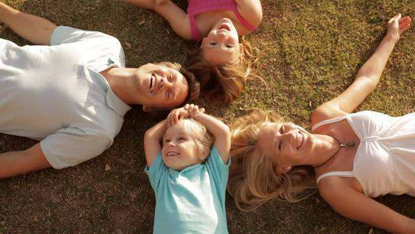 family group lying on grass Royalty-free stock video