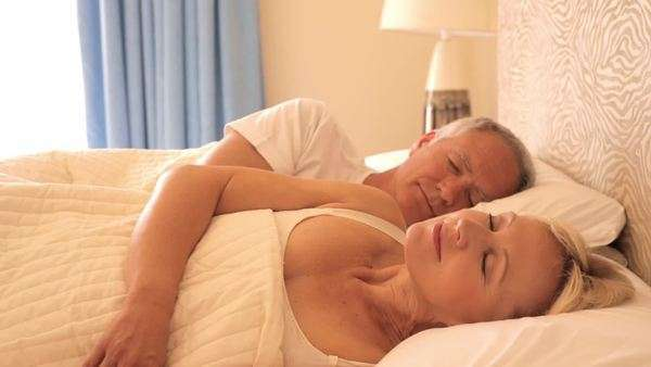 dolly shot of senior couple asleep in bed Royalty-free stock video