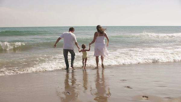Parents and daughter running in the sea. Royalty-free stock video