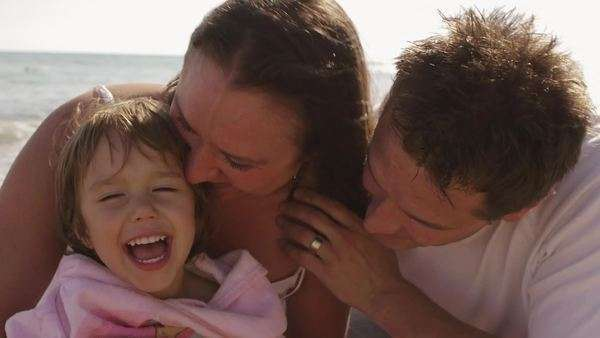 Happy family hugging together at the beach. Royalty-free stock video