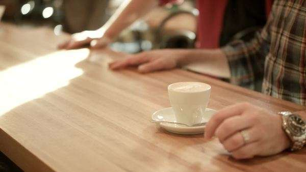 Focus in on a coffee drink in front of a customer Royalty-free stock video