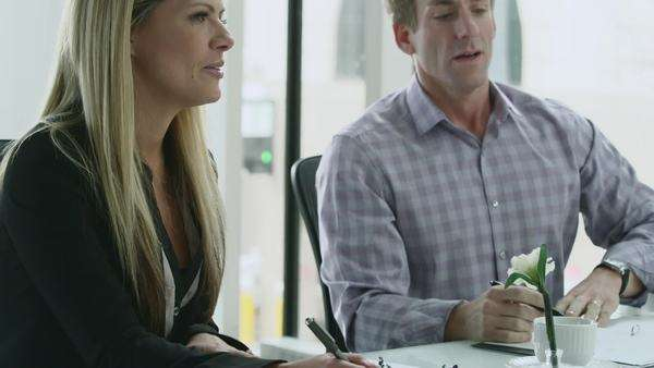A woman and man talk during a casual business meeting Royalty-free stock video
