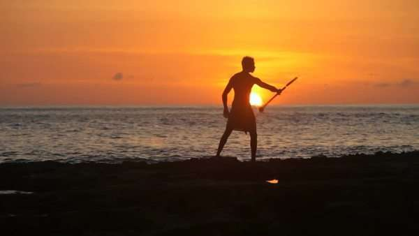 Hawaiian fire knife dancer performs at sunset Royalty-free stock video