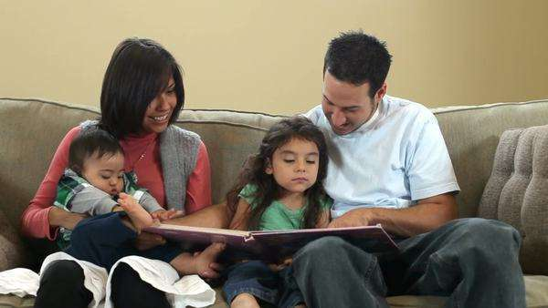 Family reading a book together Royalty-free stock video