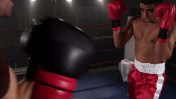 Boxers fight in boxing ring Royalty-free stock video