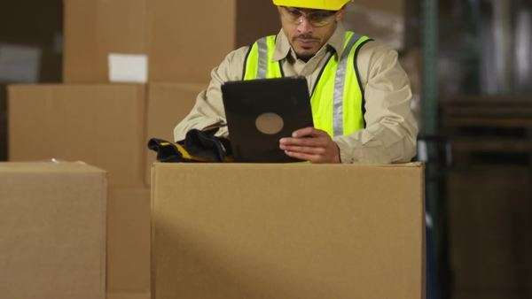 Industry worker using digital tablet in shipping warehouse Royalty-free stock video