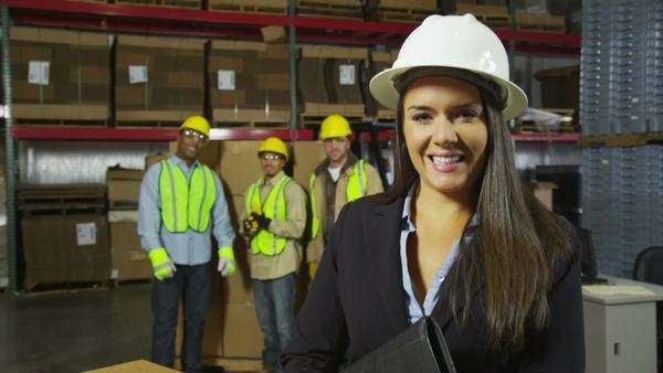Portrait of businesswoman with workers in background Royalty-free stock video