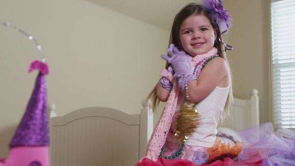 Young girl having fun dressing up in costumes Royalty-free stock video
