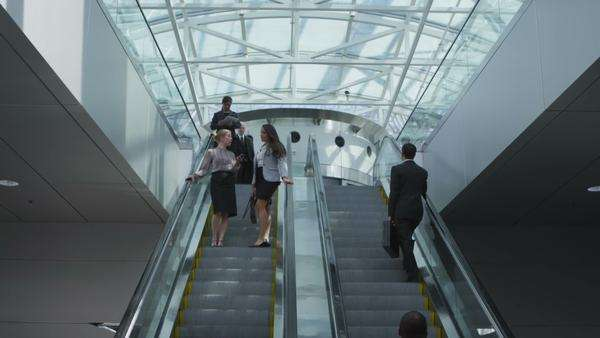 Businesspeople on escalator Royalty-free stock video