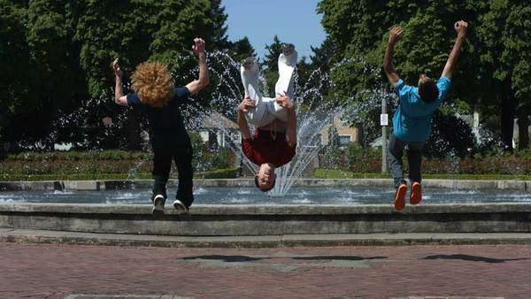 Backflips in front of fountain, slow motion Royalty-free stock video