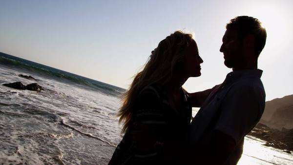 Young couple on the beach Royalty-free stock video
