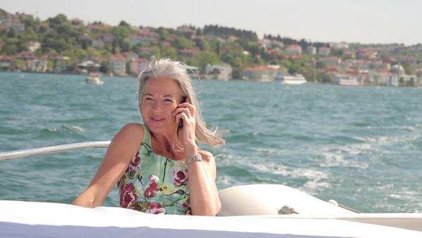 Senior female calling on yacht Royalty-free stock video