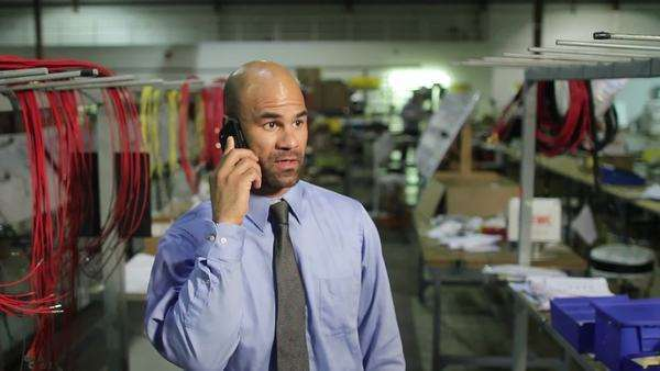 Business man on happy phone call in industrial setting Royalty-free stock video
