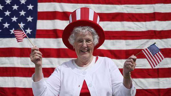 Elderly woman celebrates 4th of July Royalty-free stock video