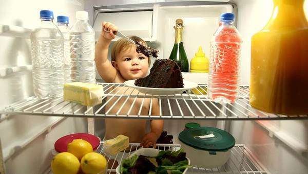 Baby eating chocolate cake in refrigerator Royalty-free stock video