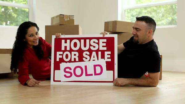 Couple in new home with sign Royalty-free stock video