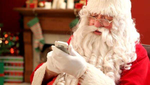 Santa Claus talking on cell phone Royalty-free stock video