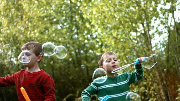 Blowing bubbles, slow motion Royalty-free stock video