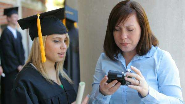 Graduate and mother take self portrait Royalty-free stock video