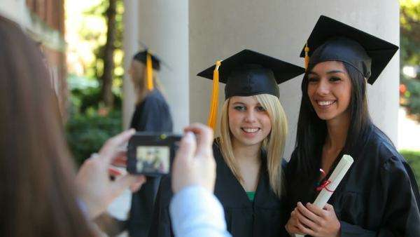 Graduates taking photos together Royalty-free stock video